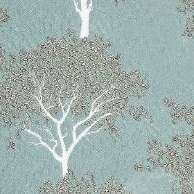 Keaton - Duck Egg - Dusky blue 100% polyester fabric behind a stylish pattern of trees made withwhite trunks and elegant silver leaves