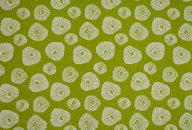 Moira - Apple - Patterned white shapes with irregular outlines and sizes repeatedly patterning lime green coloured 100% cotton fabric