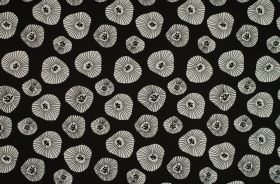 Moira - Black - Patterned white shapes of different sizes printed on a jet black 100% cotton fabric background
