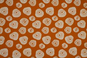 Moira - Orange - Burnt orange and white coloured 100% cotton fabric patterned with shapes of different sizes with irregular rounded edges