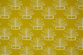 Valja - Ochre - Fabric made from 100% cotton in mustard yellow, with a repeated pattern of white outlines of leaves and geometric shapes