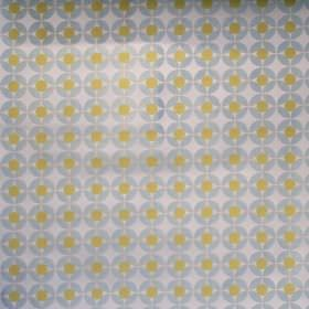 Reece - Meadow - White fabric with a grid of blue spots with meadow green spots inside them