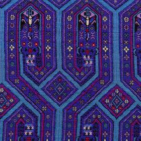 Niu Fret - Lapis - Bright, vibrant shades of blue and purple making up patterned, angular lines on fabric made from 100% sunbrella acrylic