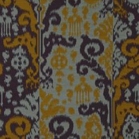 Cassia Ikat - Chartreuse - Bold ethnic style patterns covering cotton and silk blend fabric in gold, slate grey and cement grey colours