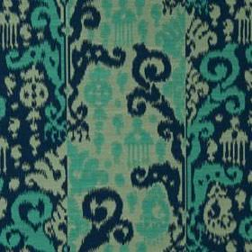 Cassia Ikat - Lagoon - Fabric blended from cotton and silk in jade, navy and bright turquoise, featuring a pattern of bold tribal style desi