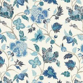 Enchanted Vine - Indigo - White 100% linen fabric patterned with large leaves and vines shaded in various light and dark blue tones
