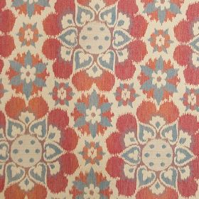 Antalya - Red - A brightly coloured floral style design repeatedly printed in red, pink & blue on a pink-grey blended fabric background