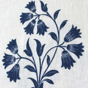 Sophie - Blue - Elegant navy blue tulip style florals with simple leaves arranged on 100% linen fabric in a very pale shade of blue