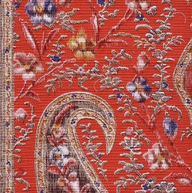 Tigers Eye - Red - Bright orange linen union fabric behind a detailed embroidered design of tiny florals and grey, pink and blue paisley shapes