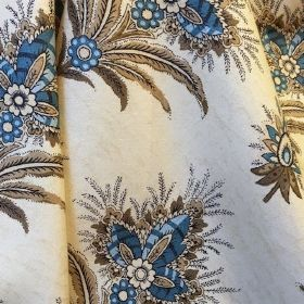 Cochin - Beige Blue - Cream fabric made out of cotton decorated with large blue leaves that have white flower inside of them