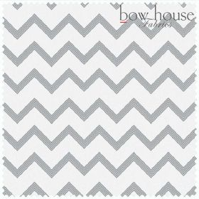 The Chevron - Ash - Bright white bleached linen fabric as a background to a pattern of steel grey coloured zigzag stripes