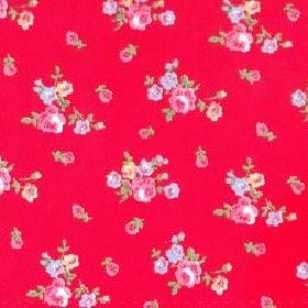Sprig - Red - Cotton fabric with red background depicting small roses and leaves