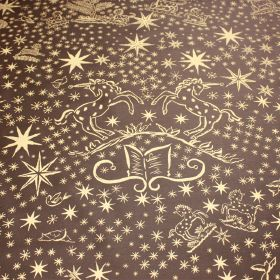 History Gold - Brown - Cream coloured unicorns, books, swirls and stars printed on a dark grey 100% cotton fabric background