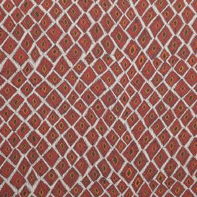 Africana - Berry - White 100% linen fabric behind abrick red, orange and dark grey design of uneven, square-diamond type shapes