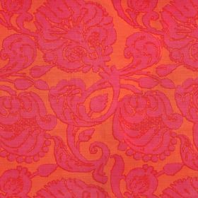 Anna - Hot Pink - Fabric made from bright orange linen with a large floral pattern in hot pink with bright red outlines