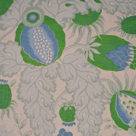 Carnival - Green - Bright green and blue thistle shapes with large, light grey leaves on a warm cream coloured 100% linen fabric background