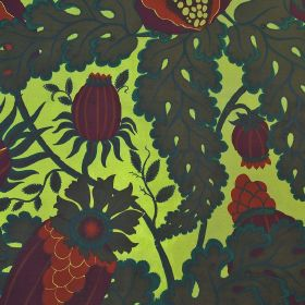 Carnival - Kiwi - 100% linen fabric in lime green behind a thistle and leaf pattern in very dark shades of green, purple, red and blue