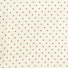 The Littletons - Raspberry - Fabric made from 100% linen, featuring a small, regular polka dot pattern in off-white and fuschia colours