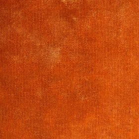 Syvota - 117 - Swatch of fabric finished with a mottled bright orange pattern
