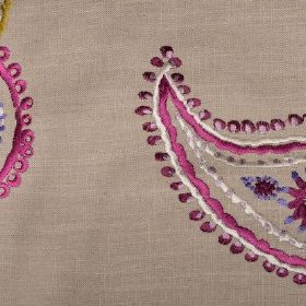 Odalisque - Cerise - Dark pink, purple and white detailed paisley shapes embroidered onto light brown coloured linen fabric