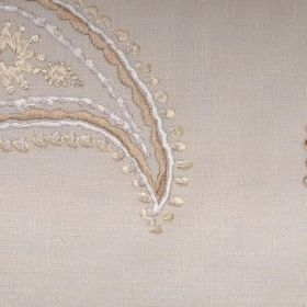 Odalisque - Chalk - Expensive looking gold and white embroidery in paisley shapes on a pale mocha coloured linen fabric