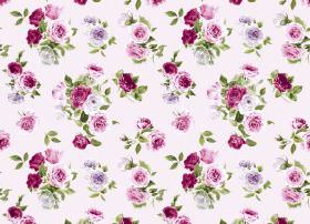 Summer Bloom - Pink - White fabric with a floral design in shades of pink and purple, with light green coloured leaves