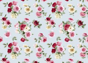 Summer Bloom - Duck Egg - Bunches of roses in deep red, light pink and cream colours, with green leaves, on fabric in a very light blue colo