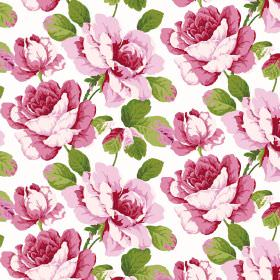 Monroe - Fuchsia - Bright green leaves printed with large flowers in different shades of pink on a fabric background in plain white