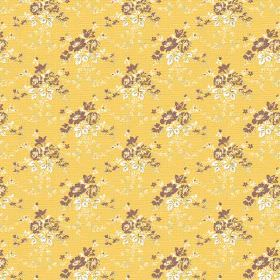 Daphne (Linen Union) - 2 - Brown and cream coloured flowers printed on a custard yellow linen fabric background
