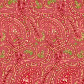 Dharamsala Paisley (Cotton) - 3 - A pattern of green and pink curving lines and dots printed on a red cotton fabric background