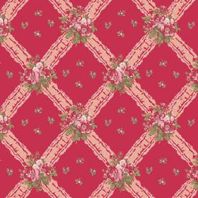 Uzes (Cotton) - 1 - Salmon pink coloured diagonal grid pattern with pink and green flowers printed on a bright pink cotton fabric background
