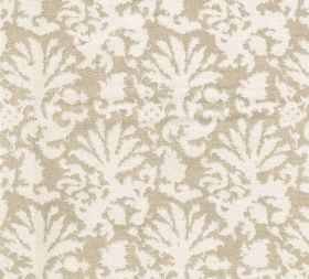 Cotton - Aylsham - A large, repeated design of abstract leaf-style shapes in white printed on beige fabric made entirely from cotton