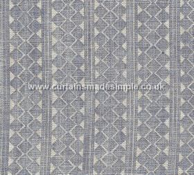 Quantock - QUAN-006 - Vertical stripes and rows of triangles and geometric stripes printed roughly on 100% linen fabric in blue-grey and off-whi