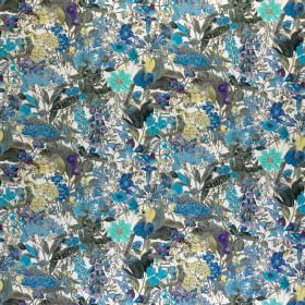 Chelsea - Abundance - Various light, bright and dark shades of blue making up a small, busy floral pattern on fabric made from 100% cotton