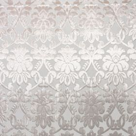 Ferrara - Cremisi - Elegant, detailed patterns shaded from white to chrome grey on a light grey coloured 100% polyester fabric background
