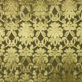 Ferrara - Verde - Detailed patterns shaded in creamy green tones on a very dark forest green coloured 100% polyester fabric background