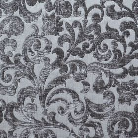 Liberty - Peltro - Light blue hard wearing fabric with silver coloured swirls as a raised, textured pattern