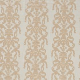 La Quinta - Tanin - White hard wearing fabric as a background for an ornate design of swirls which runs vertically in rows