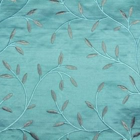 Camilla - Teal - Simple stems and leaves making up an elegant viscose embroidered design on 100% polyester fabric in bold turquoise and grey