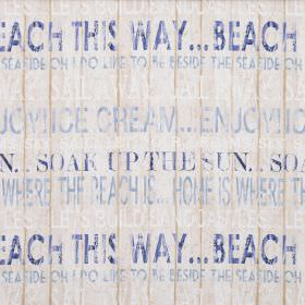 Boardwalk - Harbour Blue - Off-white coloured fabric made entirely from cotton, printed with seaside themed text in light blue and navy blue