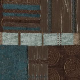 Prague - Teal - Elegant espresso and sky blue shades making up a patterned patchwork style print on polyester, viscose and cotton fabric