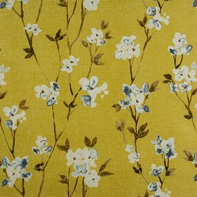 Alicia - Honey - White and dark blue flowers creating a roughly printed design on a rich gold coloured 100% cotton fabric background
