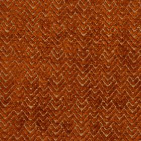 Reno - Terracotta - Textured zigzags and chevrons patterning fabric made from rich rust coloured viscose and polyester
