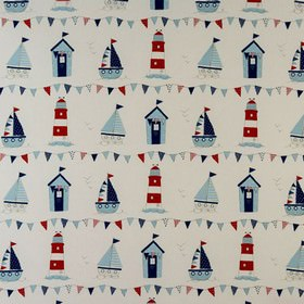 Maritime - Blue - Beach themed fabric with sailboats, beach huts, lighthouses and bunting in blues, reds and creams on 100% cotton fabric