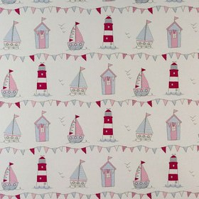 Maritime - Pink - 100% cotton fabric with a pink, blue, cream and bright red beach theme with beach huts, lighthouses, sailboats and bunting