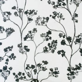 Kew Baltic - Charcoal - Dark grey and black blossoms connected by stems and vines over a white fabric background made from linen and cotton