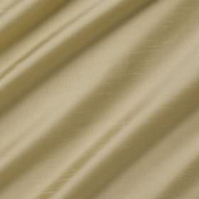Astor - Loaf - Swathes of fabric made from 100% polyester in a gold colour that has a very subtle greenish tinge