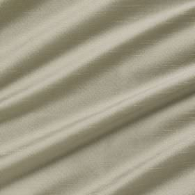 Astor - Cuckoo - Chrome coloured 100% polyester fabric arranged in folds