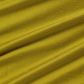 Astor - Goldcrest - Vibrant green-gold coloured swathes of fabric made entirely from polyester