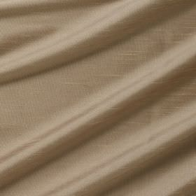 Astor - Irish Cream - Folds of mocha coloured 100% polyester fabric with a slightly shiny finish